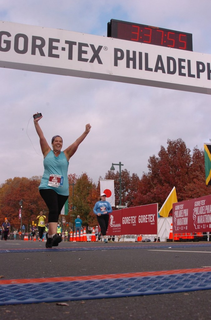 Crossing the finish line of the Philadelphia Half Marathon in 2013. This photo was so meaningful to me that I put it on the cover of my book!
